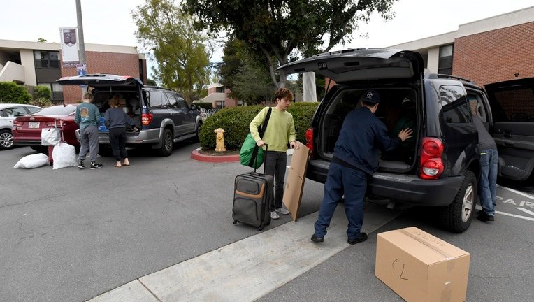 CSULB students move out of dorms as school closure is extended through end of semester.
