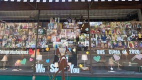 Downtown Osceola store fills window front with photos of graduating seniors