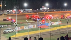 Man killed after school bus rolls onto him during races at Wisconsin speedway