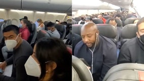'I've never felt so unsafe': American Airlines passenger shares video of 'overcrowded' plane