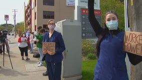 Nurses protest outside United Hospital for use of hospital-issued scrubs