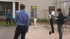 East Ridge High School acapella group serenades Woodbury Senior Living residents