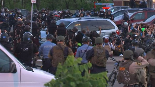 Authorities say 150 protesters are being taken into custody as Minneapolis enforces curfew