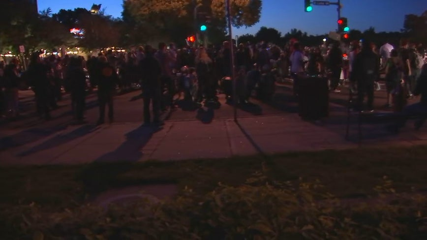 Crowd runs away after St. Paul police fire tear gas as protesters attempting to cross bridge into city