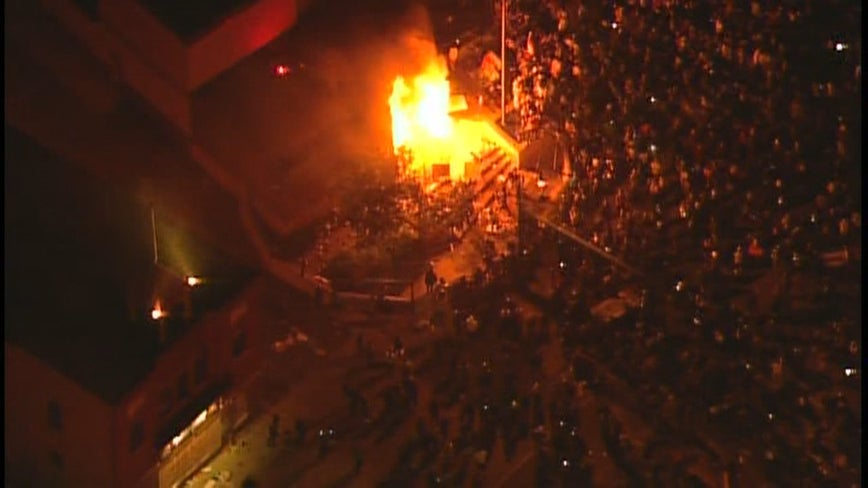 Officers evacuated as rioters set Minneapolis police precinct on fire