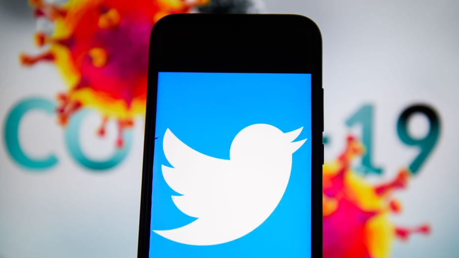 In this photo illustration a Twitter is seen displayed on a