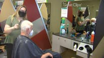 As COVID-19 restrictions ease, customers flock to hair salons, restaurant patios