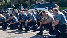 St. Paul Police officers seen kneeling in solidarity with protesters at Governor's Mansion
