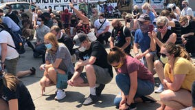 Minneapolis neighbors take knee on sidewalk for 8 minutes 46 seconds