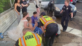 Minnesota bride in wedding dress stops to help injured crash victim
