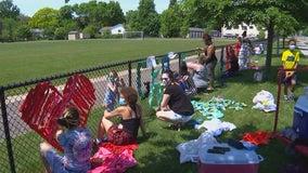 Students, teachers create George Floyd tribute on Richfield fence