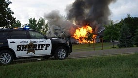 Suspect found dead in trailer following standoff and fire in Andover, Minnesota