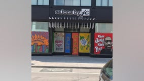 Artists paint murals honoring George Floyd on plywood protecting businesses around Minneapolis