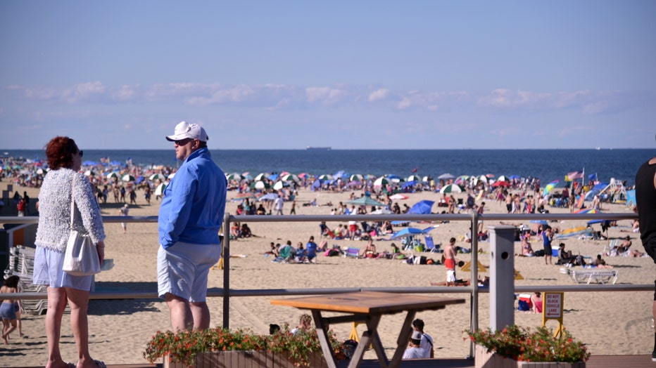 eca11988-Crowds Flock To Jersey Shore For Summer Weather On The Weekend