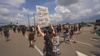 Marchers walk 6 miles in summer heat from MOA to Minneapolis to bring calls for change to suburb