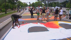 Artists create 'Black Lives Matter' mural along Plymouth Avenue in Minneapolis