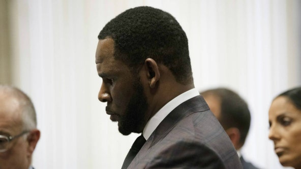 Feds: Men with ties to R. Kelly threatened his accusers