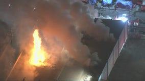 Crews battle large fire at DTLA commercial building, 1 firefighter hurt