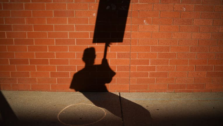 shadow of nurse picketing