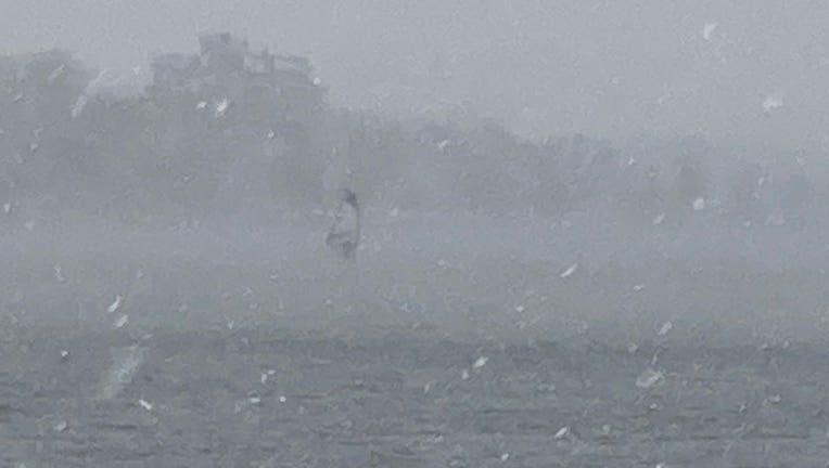 Windsurfer on Bde Maka Ska during snowstorm