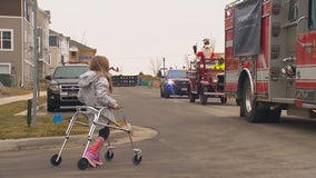 Santa makes special visit, riding a fire truck to see young girl in Victoria, Minnesota