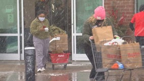 Last-minute shoppers in Minnesota trudge through snowstorm