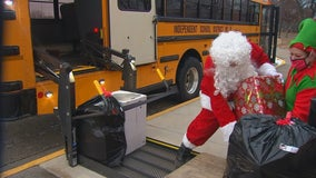 St. Francis school bus drivers help Santa with present deliveries