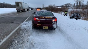 Truck slides off I-94 near Monticello, nearly hits state troopers