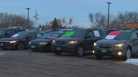 Teachers hold car rally to call for delay to in-person learning