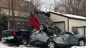 Car takes air, flips, lands on two parked vehicles in Minneapolis