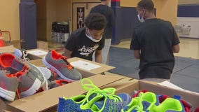 Local organizations team up to pack totes of shoes, toiletries, positive notes for Minneapolis youth