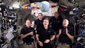 Astronauts ring in New Year with zero-gravity 'ball drop' in space