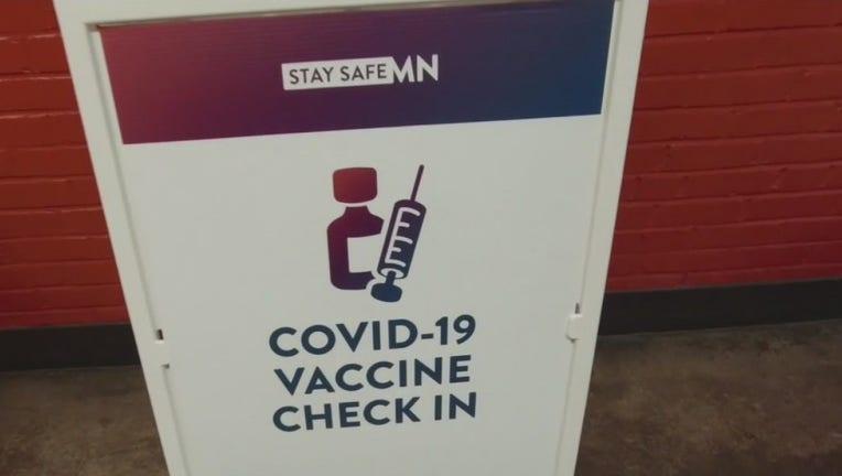 covid-19 vaccine check in sign