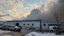 Section of warehouse partially collapses as crews battle large fire in north Minneapolis