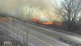 Grass fire burns along I-35W in Lino Lakes, possibly started by cigarette