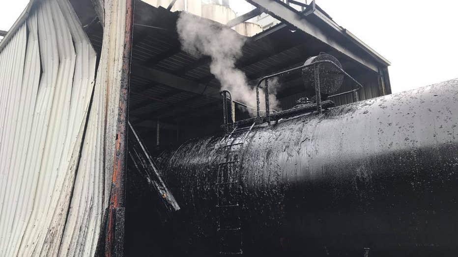 railcar molasses explosion cannon falls PD