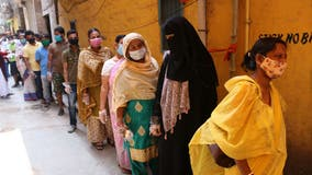 India sets another global daily record of 379K new COVID-19 cases as lines of ambulances wait at crematoriums