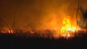 Firefighters battle brush fire at Veterans Park in Richfield, Minn.