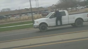 Man who drove off with officer clinging to truck charged with 4 felonies