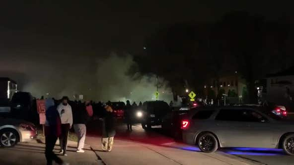 Police use flash bangs and tear gas to disperse protesters in Brooklyn Center after police shooting