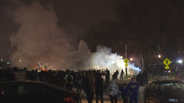 Officers disperse crowds as unrest follows police shooting in Brooklyn Center, Minn.