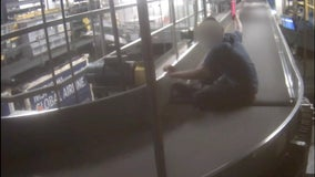 Video: Boy rides on MSP Airport baggage conveyor belt