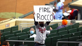 Twins fan seen holding 'Fire Rocco' sign during 3-1 loss to Rangers