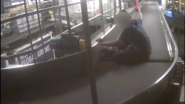 Video: Boy rides on MSP Airport baggage conveyor belt