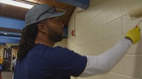 NFL star and Twin Cities native Larry Fitzgerald helps fix up Minneapolis Boys and Girls Club branch