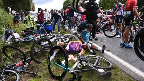 Tour de France: Woman who caused crash will be sued, officials say