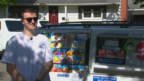Man handing over keys to family-run Twin Cities ice cream truck to little sister