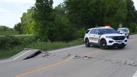 Section of Old Highway 169 buckles due to heat near Belle Plaine