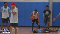 Deputies and officers build bonds with community basketball game in Hopkins, Minn.
