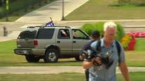 Woman waving Trump flag drives vehicle onto Minnesota State Capitol lawn
